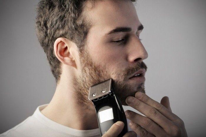 man grooming beard