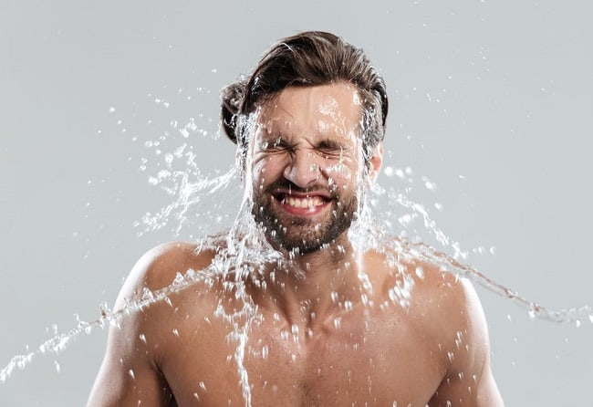man-rinsing-beard-with-water Growing A Beard for The First Time - 8 Handy Tips