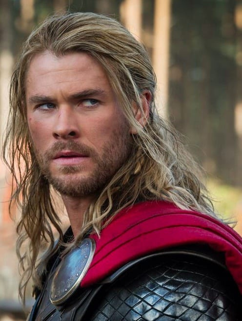 A-cool-photograph-of-Chris-Hemsworth-as-Thor-with-his-long-wavy-hair-slicked-back-into-a-manly-ponytail-hairstyle-emulating-the-look-of-ancient-Viking-males 20 Best Beard Styles for Guys with Long Hair