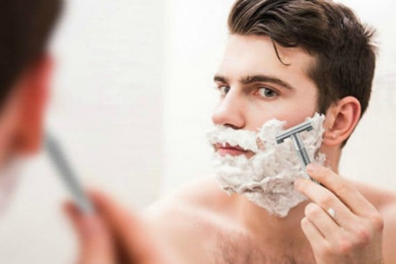 men-shaving-in-mirror-with-shaving-cream-570x381 Is Shea Butter Really Good for Beard? 5 Key Benefits