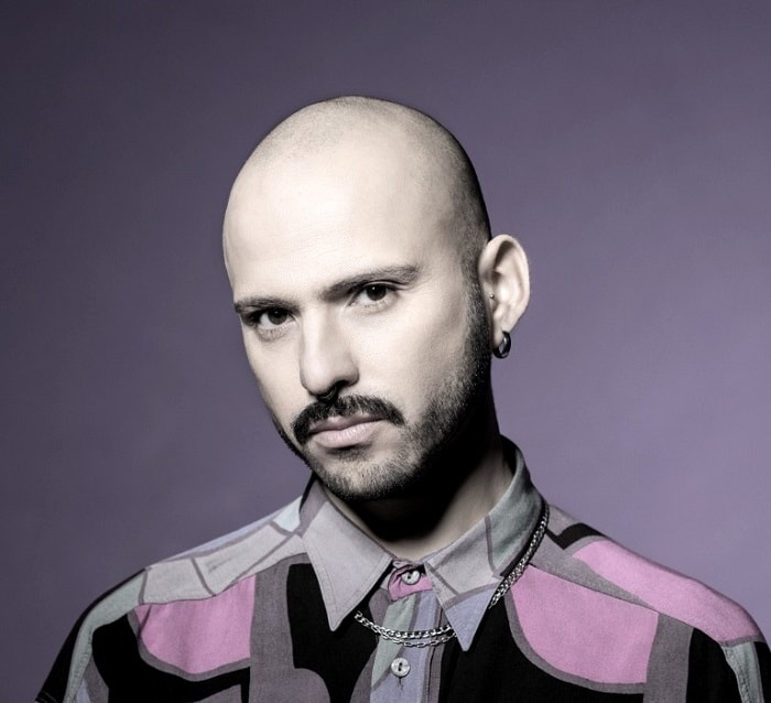 bold bald guy with mustache