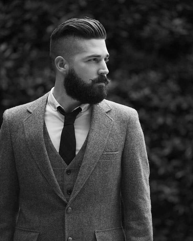 slicked short fade hairstyle with beard