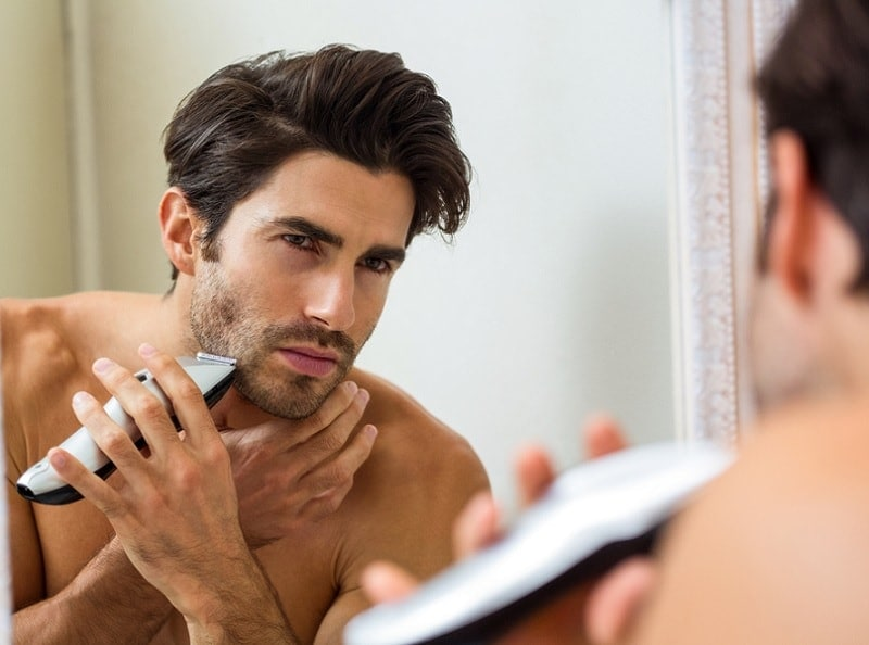 trimming-beard How to Grow A Thicker Beard: 15 Tips from The Experts