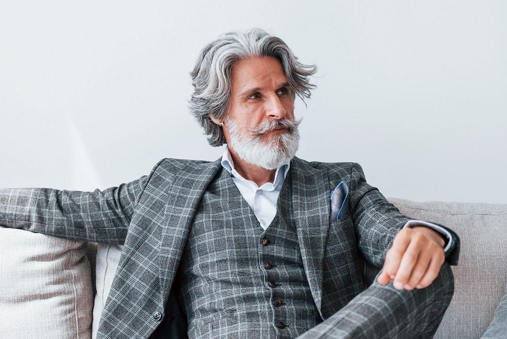 Senior stylish man with grey hair and beard