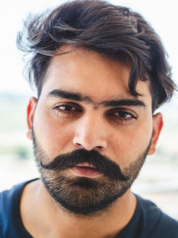 moustache with heavy stubble